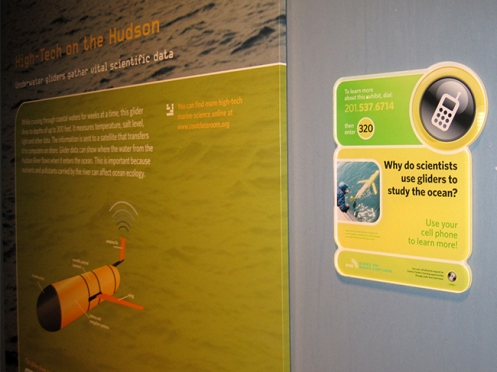 Visitors to the Liberty Science Center can hear oceanographers talk about this underwater robot glider through their cell phones. Credit: Kate Florio.