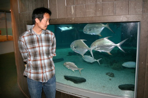 Jeffrey Yang eyes the subjects of his book of poems entitled An Aquarium.