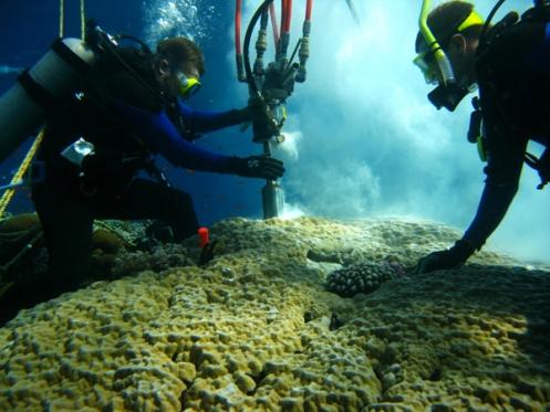 Drilling a coral core.  Credit: Konrad Hughen.