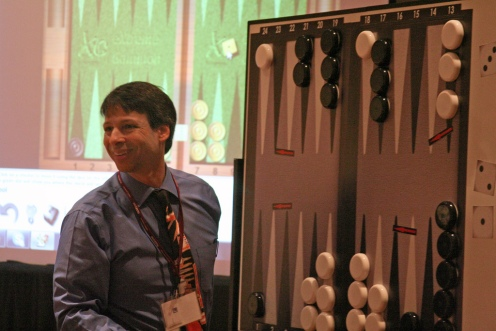Arthur Benjamin, a math professor at Harvey Mudd College, explains the strategy and math behind a game of backgammon. Credit: Mathematical Association of America.