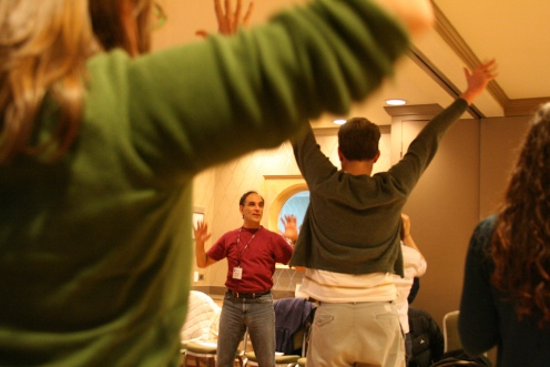 Karl Schaffer, a mathematician at de Anza College and co-director of the Dr. Schaffer and Mr. Stern Dance Ensemble, works with a class to create personal movement sequences. Credit: Mathematical Association of America.